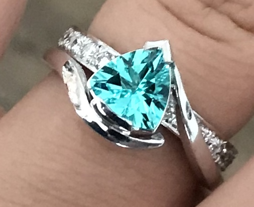 Paraiba Trilliant Cut Tourmaline & Diamond Ring finger view in natural daylight